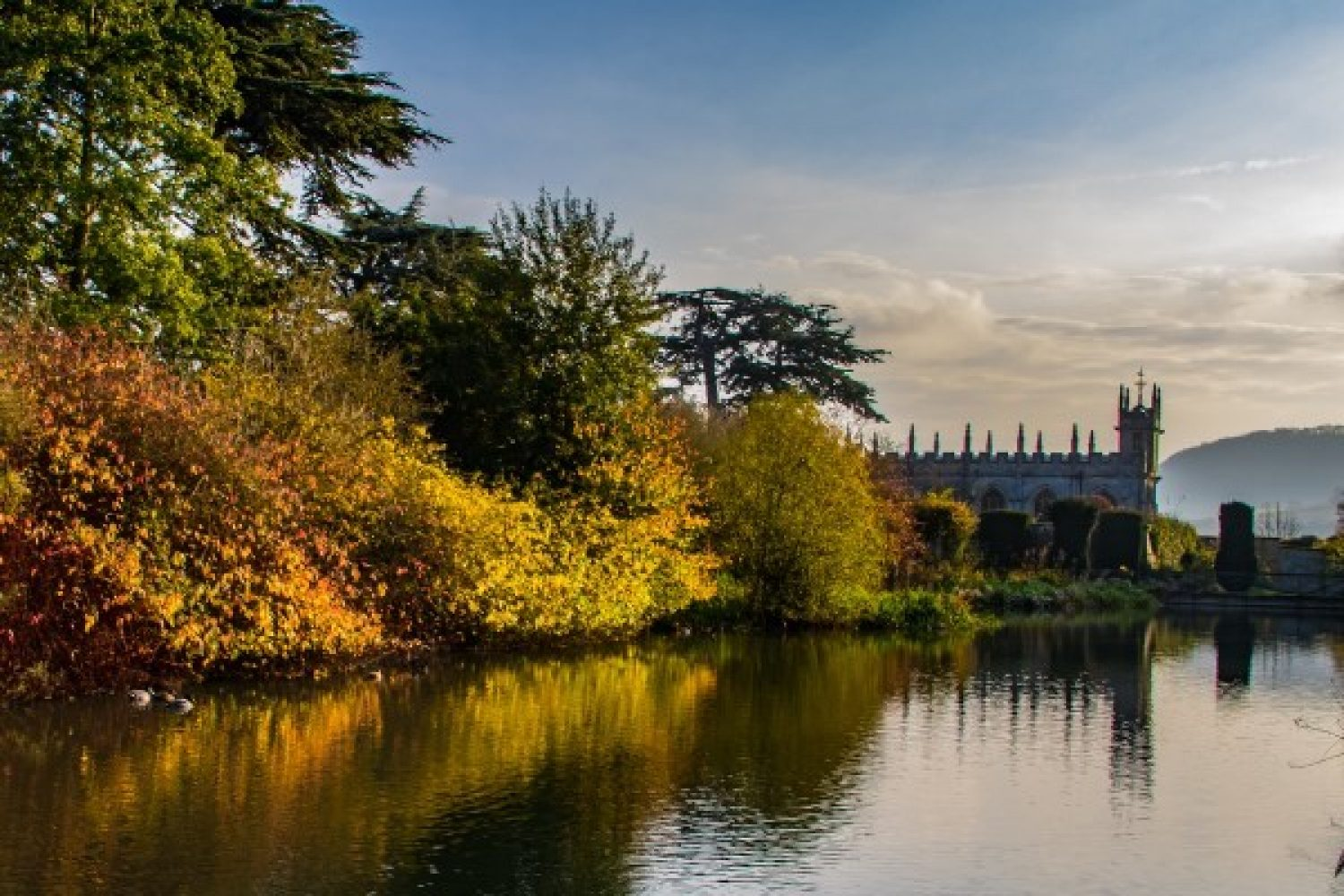 Lakeside shot of autumn foliage at Sudeley Castle