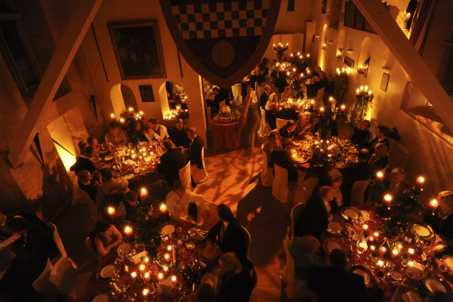 A low light shot from above of the hall filled with dining guest