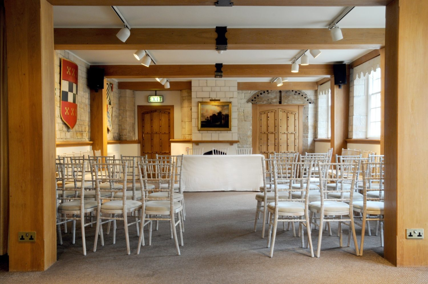 Interior shot of Chandos Hall. Rows of chairs face the table at the front of the room.