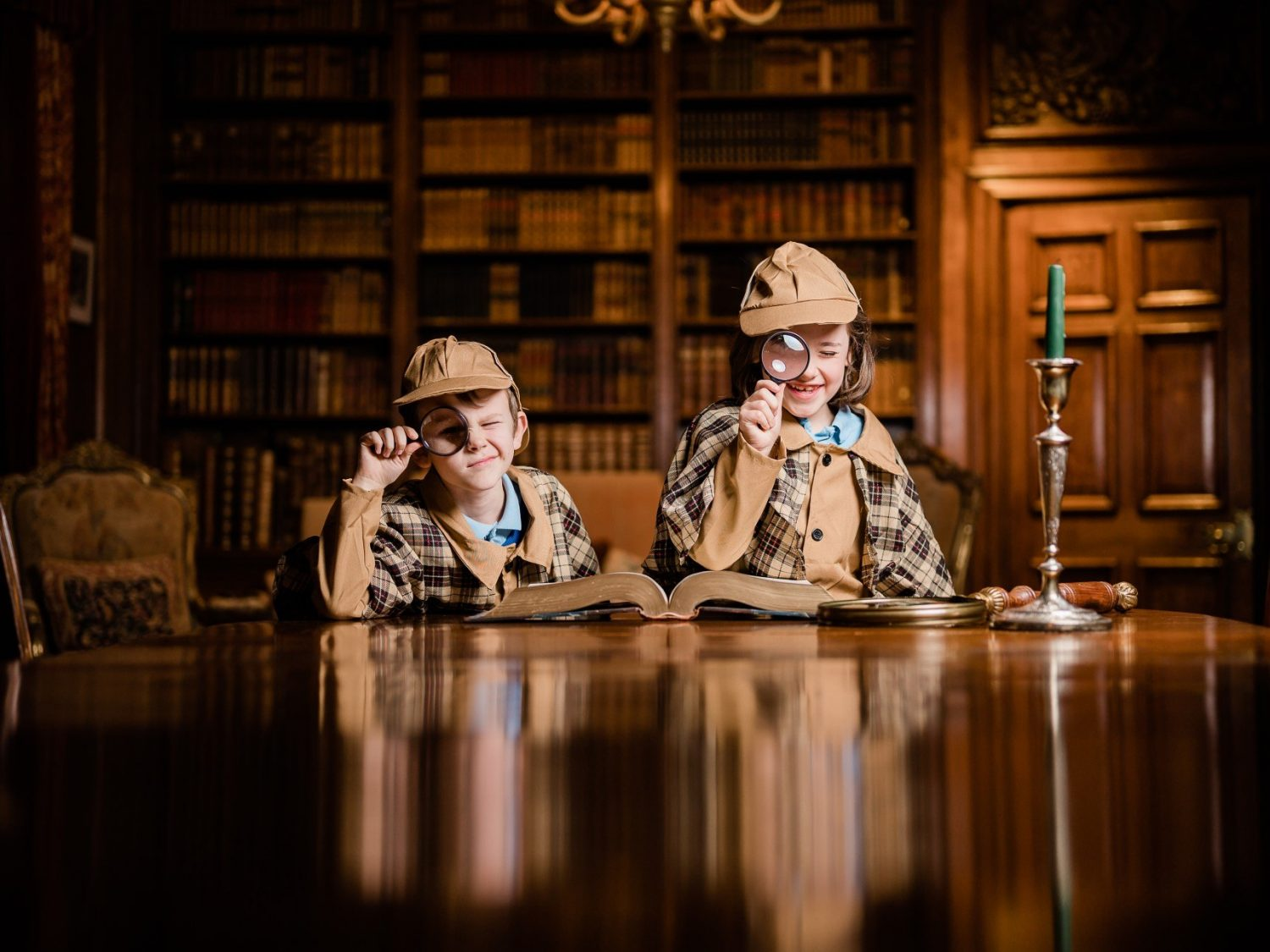 Two Children dressed as detectives in the Sudeley Library