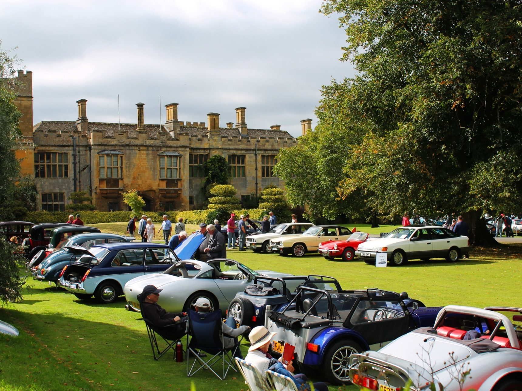 Event visitors browse the range of cars on show