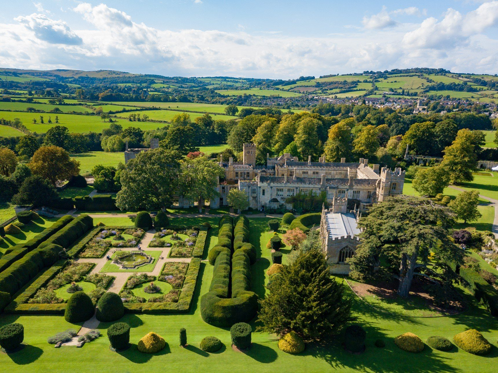 Aerial view of Sudeley Castle, gardens and surrounding estate