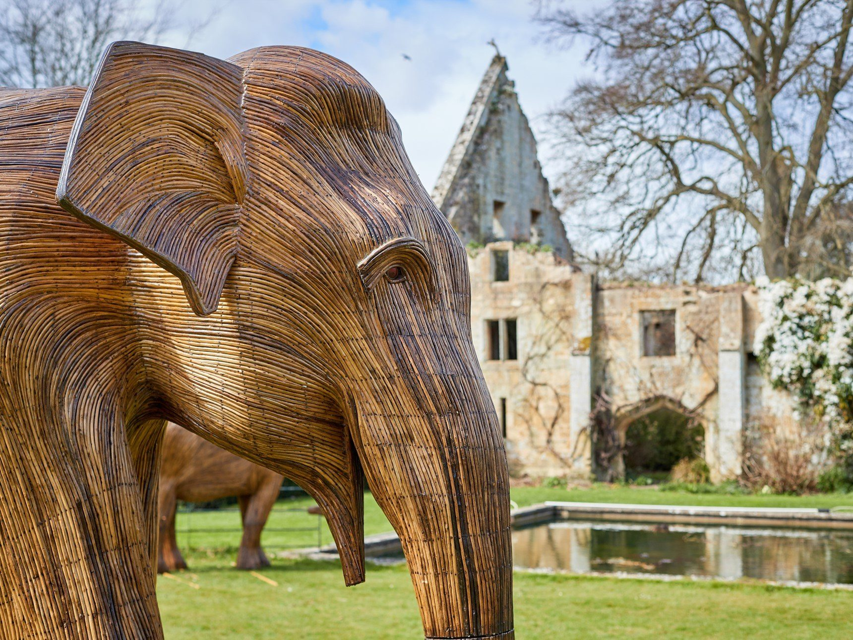 close up of elephant sculpture in front of Tithe Barn