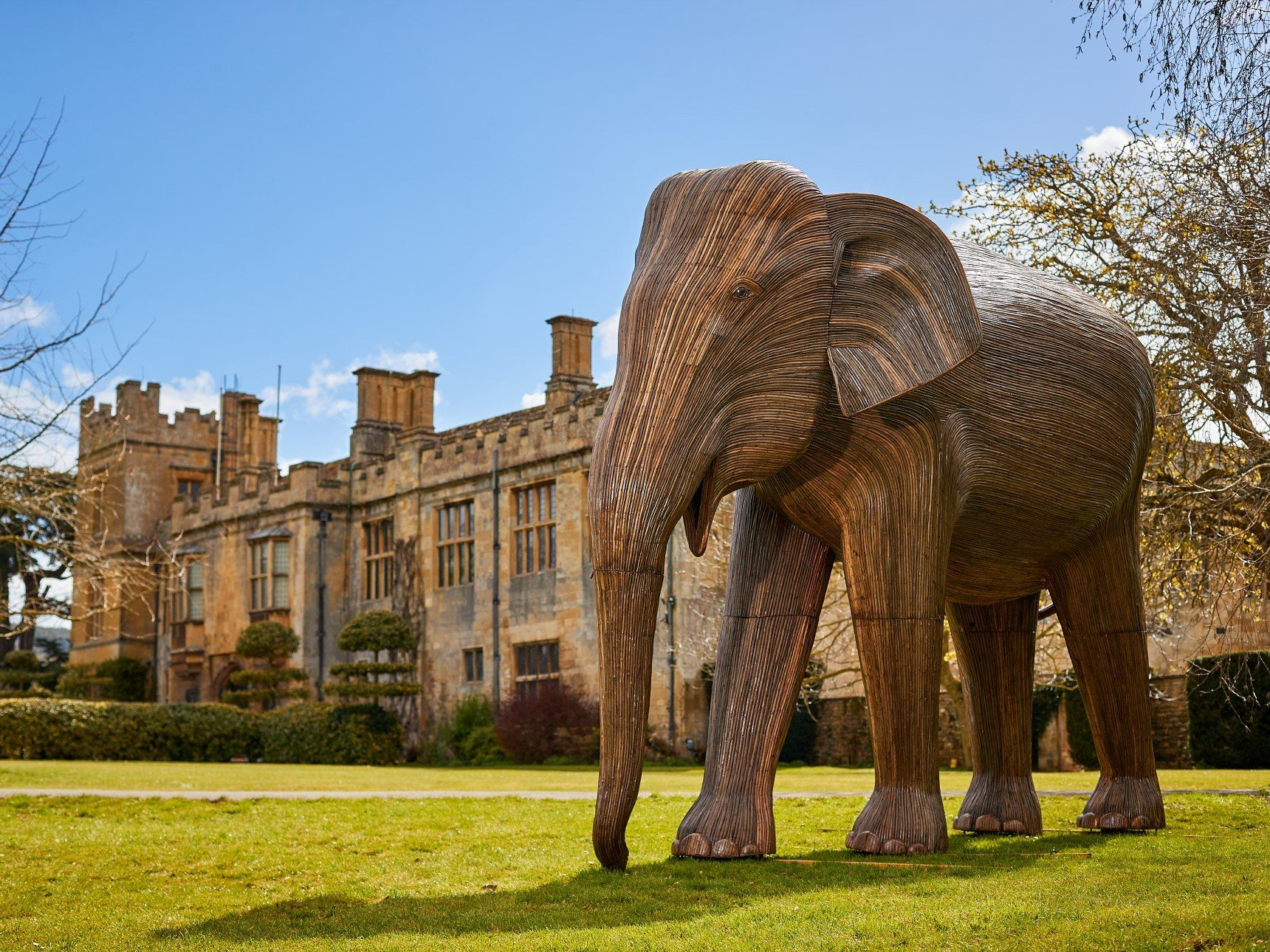 Large Bachelor Elephant sculpture in front of castle