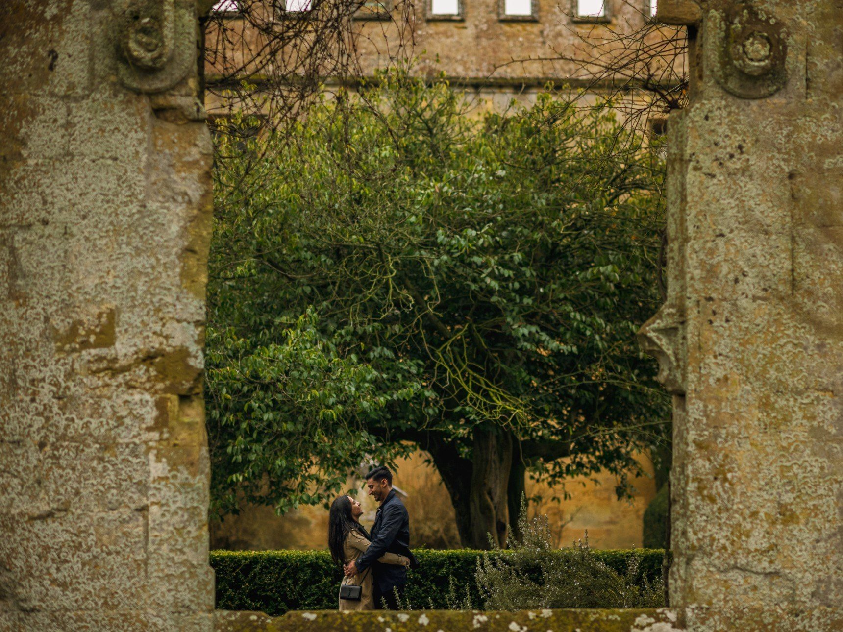Couple seen kissing through ruins