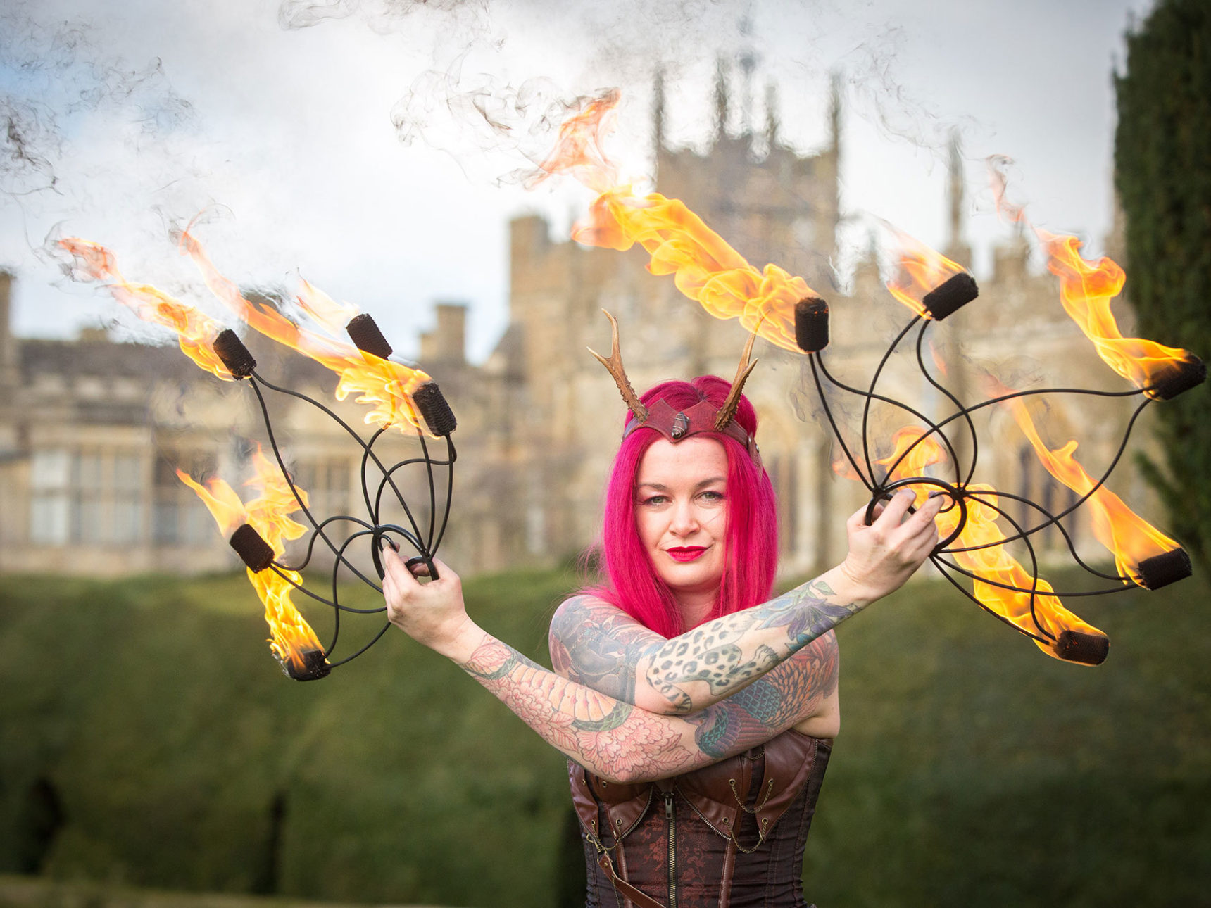 Performer wields flaming props