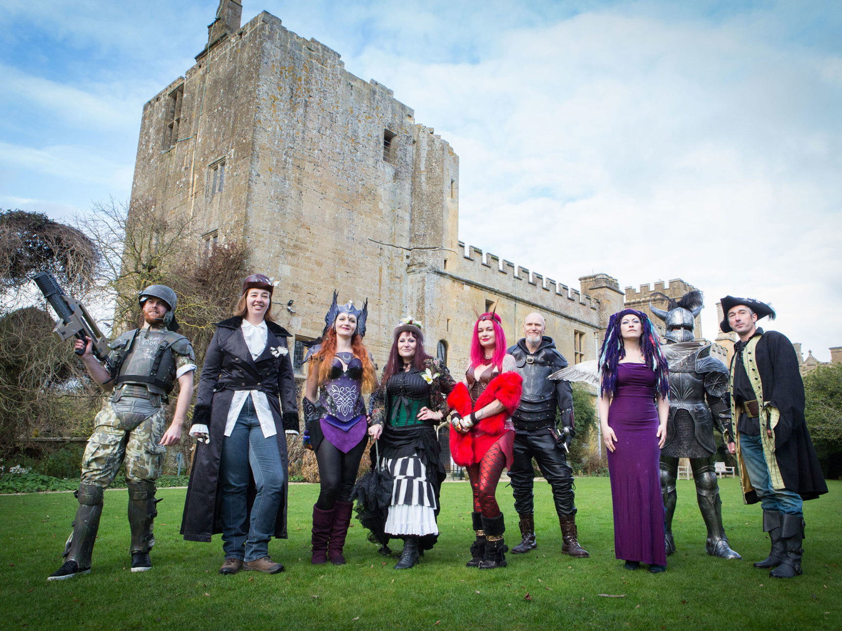 Costumed performers stand in front of castle