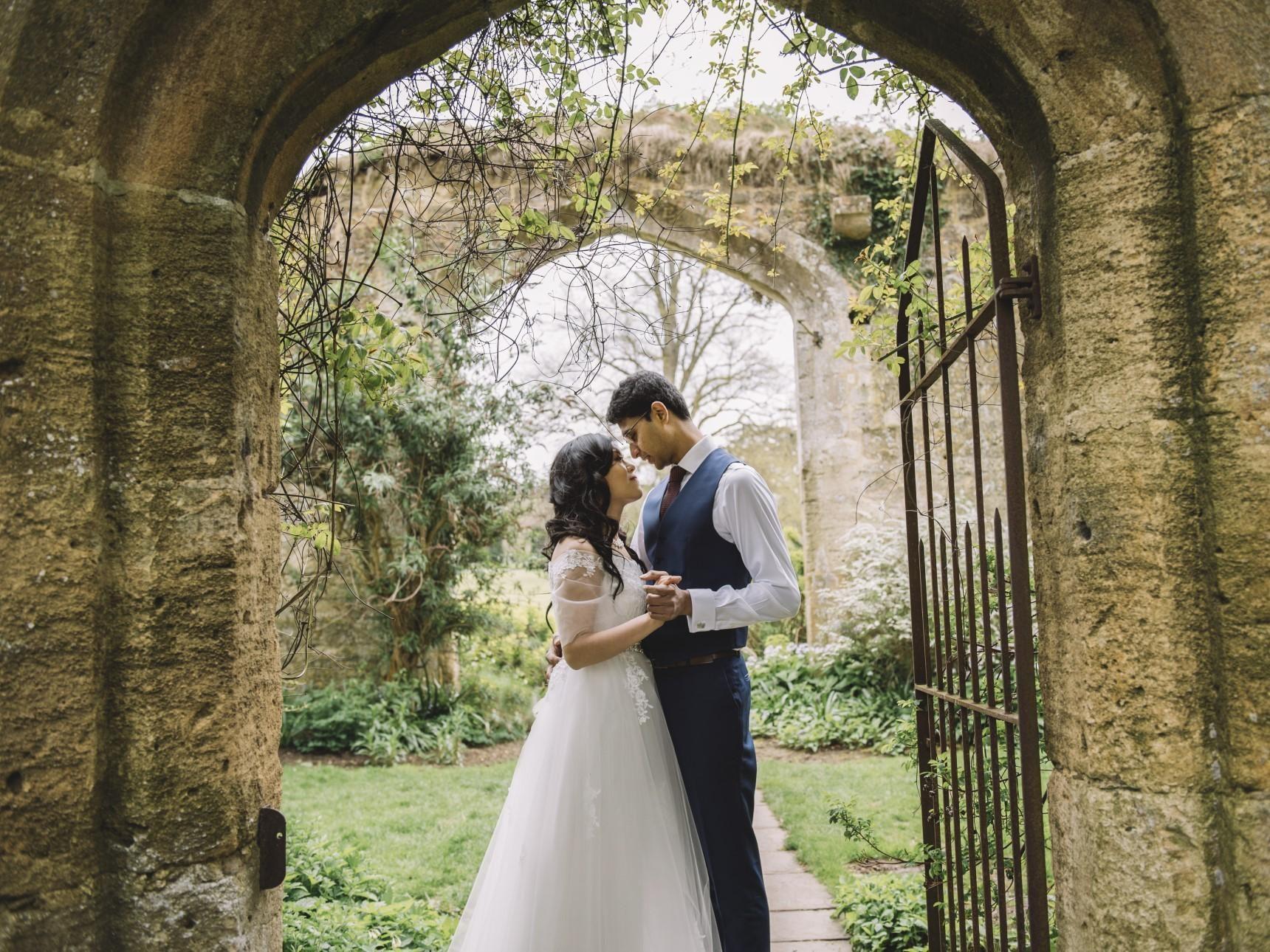Wedding couple in Castle ruins gateway