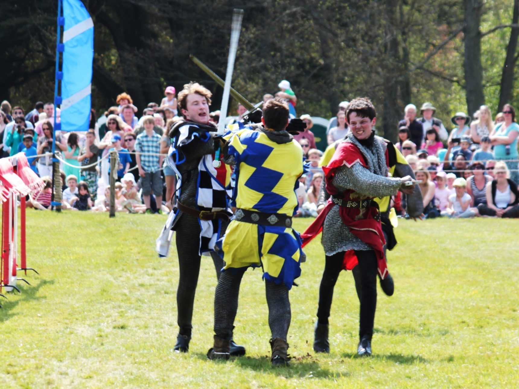 A group of knights clash on foot