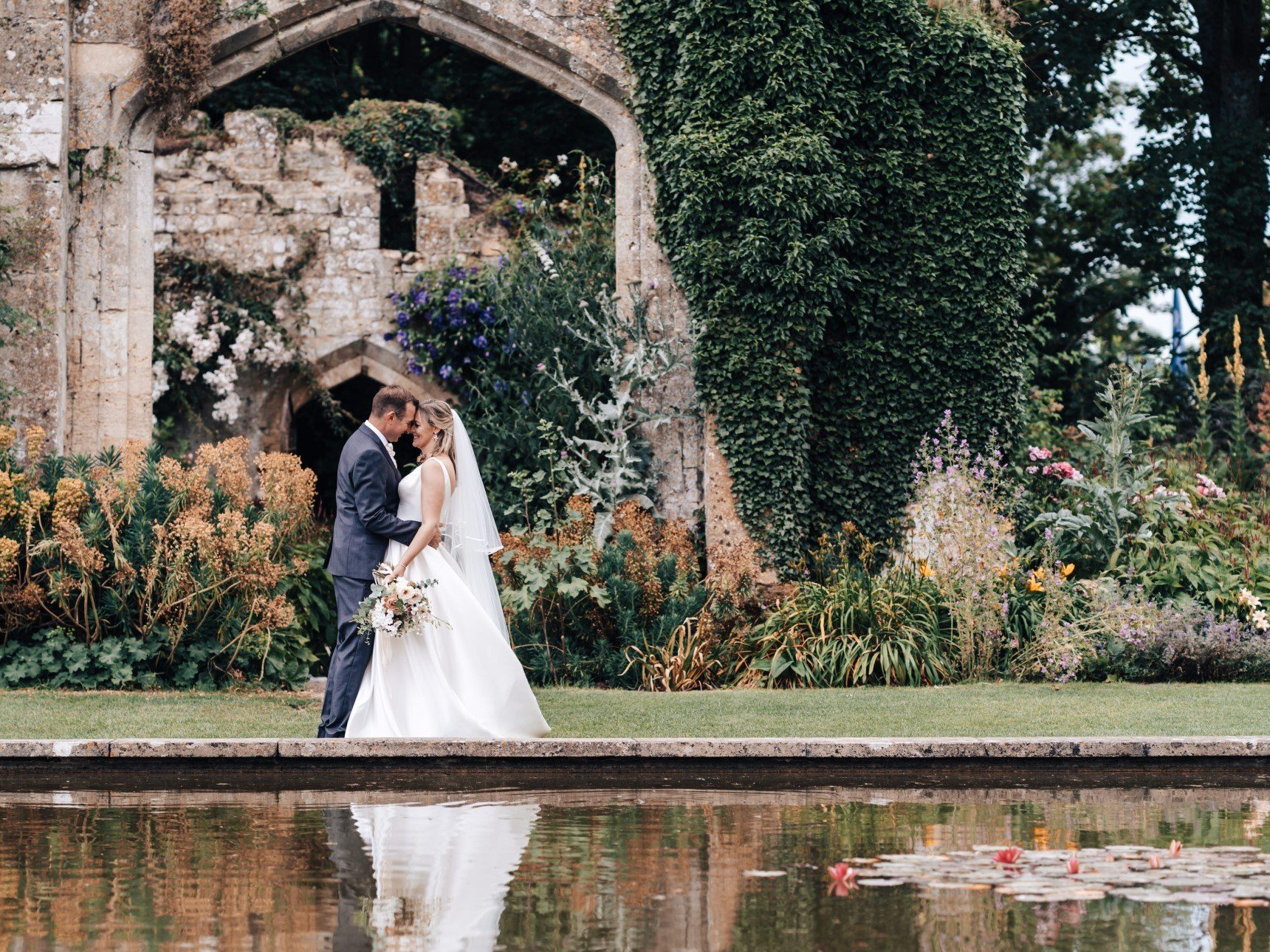 Wedding Couple in front of Tithe Barn