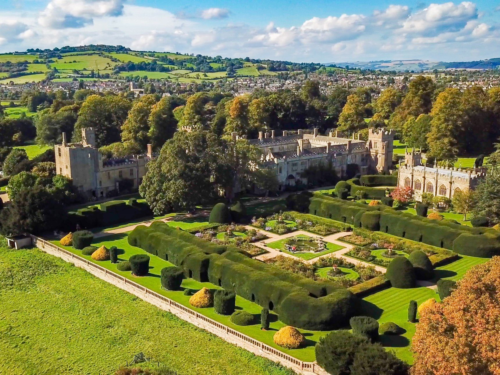 aerial view of suceley castle, gardens and wider estate